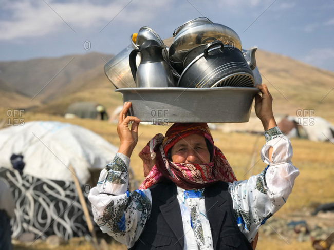 Woman carrying dishes on her head