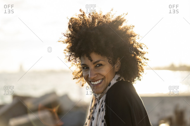 Portrait of smiling woman at backlight