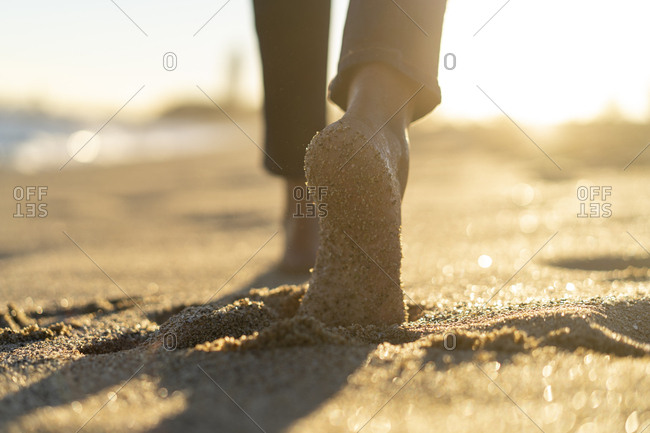 Bare feet of a woman- walking on the beach