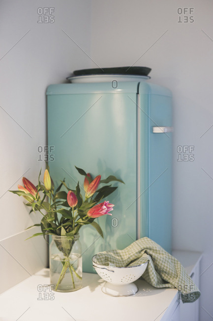 Bunch of flowers and refrigerator in kitchen