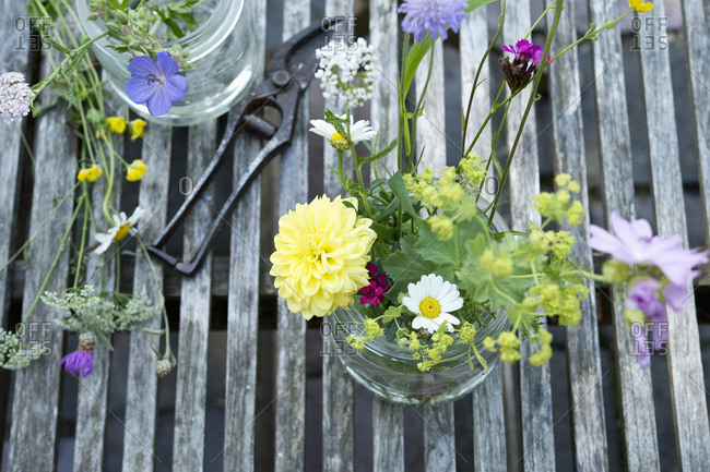 Wildflowers in preserving jar on garden table