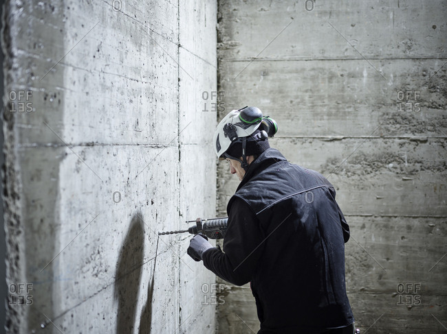 Construction worker drilling- electric drill