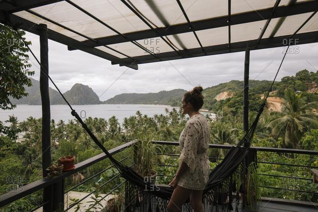 Philippines- Palawan- El Nido- woman on terrace with hammock