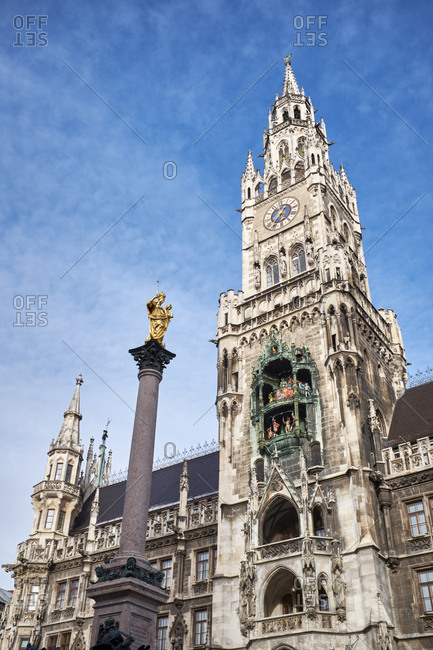 Germany- Bavaria- Munich- bell tower of the new city hall with the Marian Column on Marienplatz