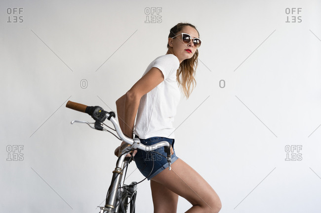 Portrait of a sexy young woman with a bicycle