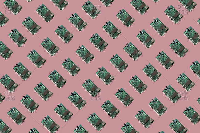 3D Illustration- row of motherboards- pink background