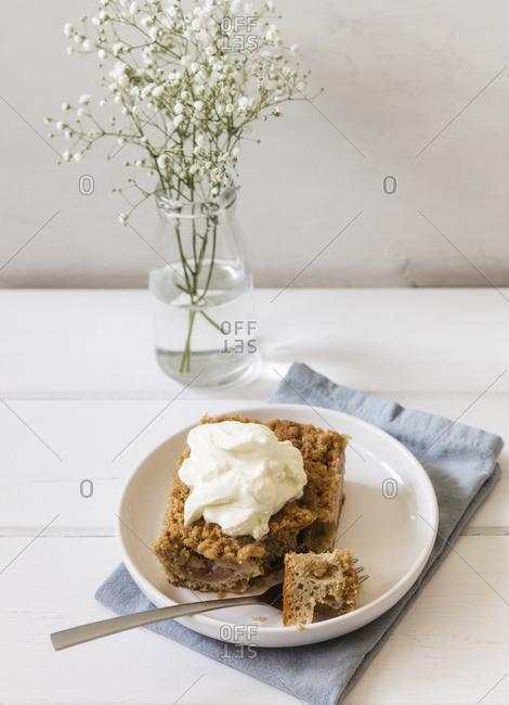 Homemade rhubarb cake with whipped cream