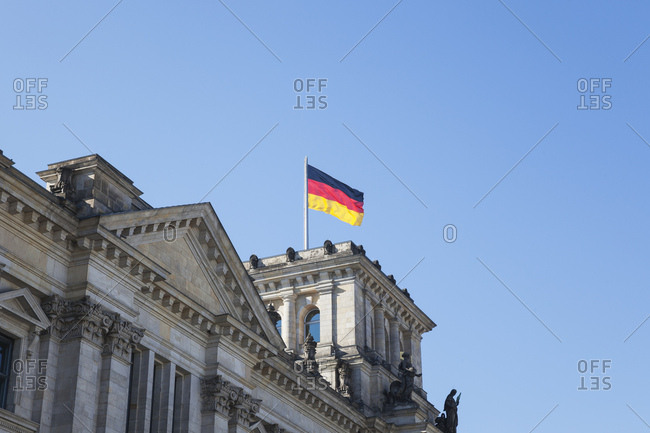 Germany- Berlin- Reichstag building and German flag