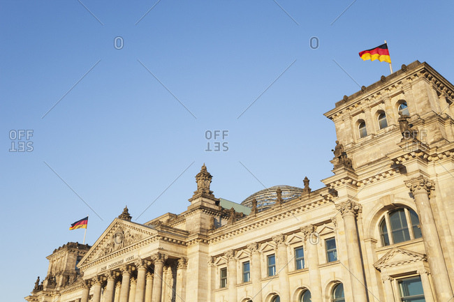 Germany- Berlin- Reichstag building and German flags