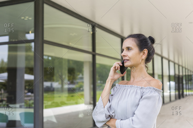 Mature woman on the phone outdoors