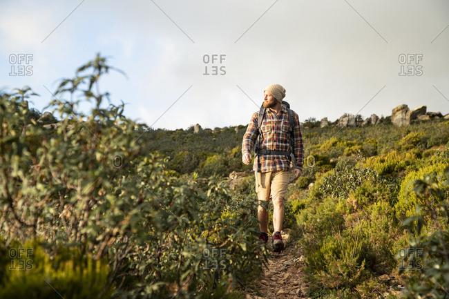 Spain- Andalusia- Tarifa- man on a hiking trip walking on a trail