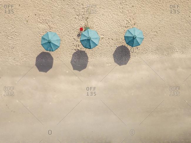 Bali- Kuta Beach- three beach umbrellas- aerial view