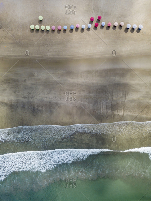 Bali- Kuta Beach- three beach umbrellas- aerial view