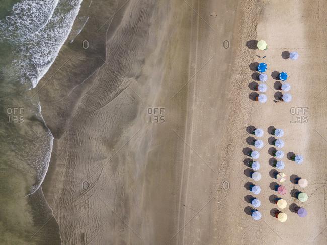 Bali- Kuta Beach- rows of beach umbrellas- aerial view