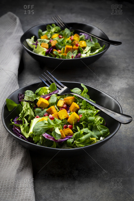 Mixed salad with roasted tofu- red cabbage- pomegranate seeds and curcuma