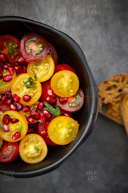 Oriental tomato salad with pomegranate seeds and mint