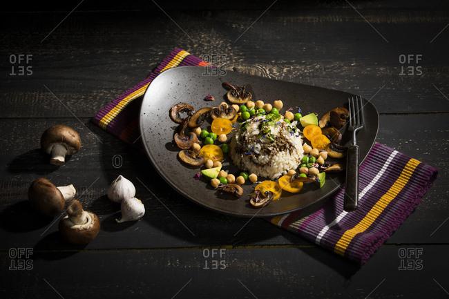 Vegan dish: natural rice with champignons- peas- chick peas- avocado and broccoli