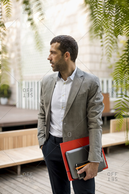 Businessman standing outdoors looking around
