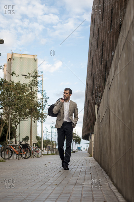 Businessman with bag walking in the city