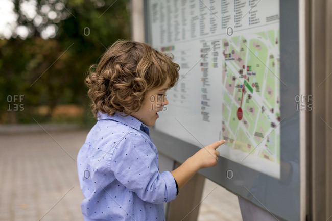 Boy looking at map in the city