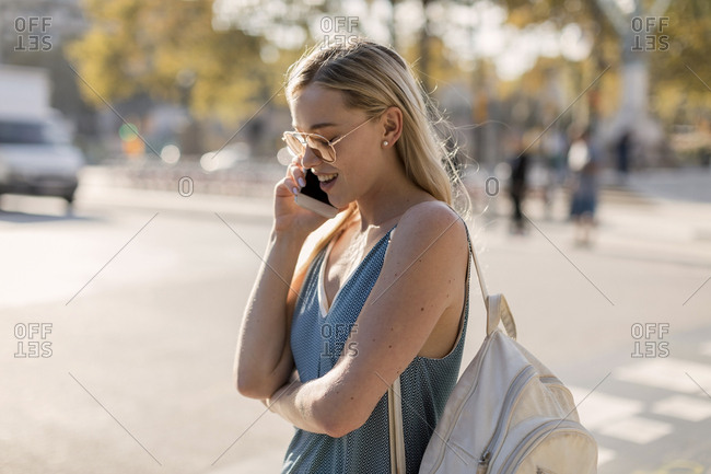 Young woman talking on cell phone in the city