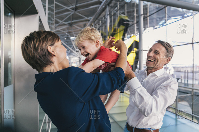 Small boy being happy upon his business mother\'s arrival at the airport