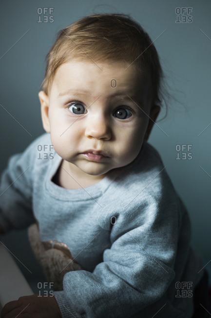 Portrait of starring baby girl