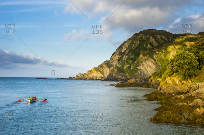 UK- England- Devon- Rowing team in the bay of Ilfracombe