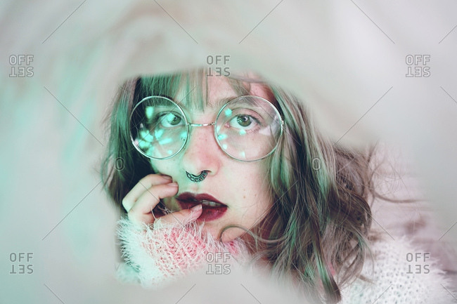 Portrait of beautiful woman wearing nose ring and glasses