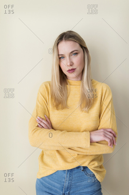 Portrait of a young woman- with arms crossed
