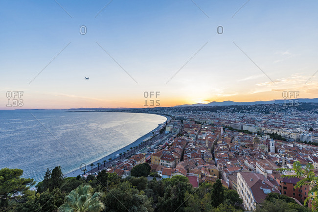 France- Provence-Alpes-Cote d'Azur- Nice- Promenade des Anglais- beach in the evening light- airplane