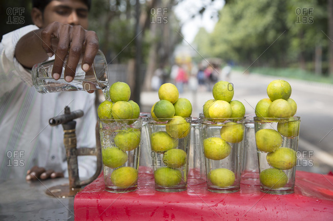 New Delhi, India - March 7, 2015: Man selling limes and fresh cold water, New Delhi, India