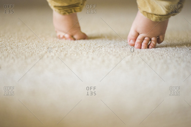 Baby toes touching carpet