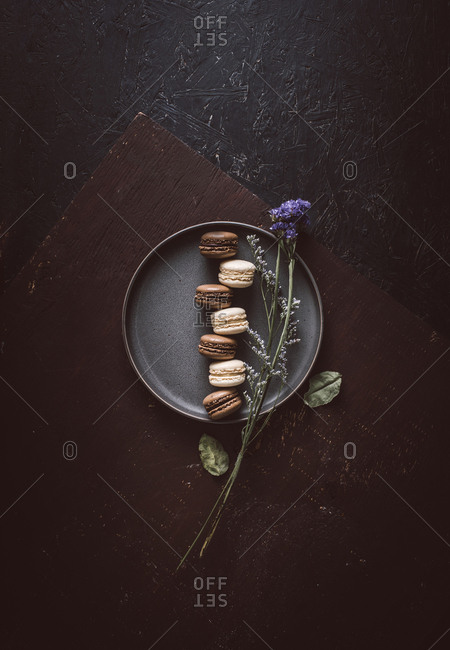 Chocolate and vanilla macarons on a plate