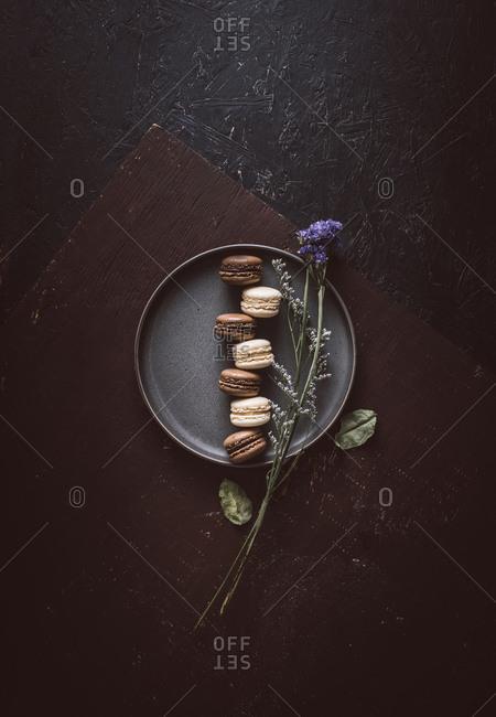 Chocolate and vanilla macarons on a plate
