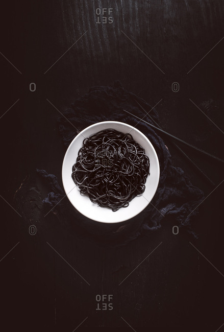 Overhead view of a bowl of squid ink pasta