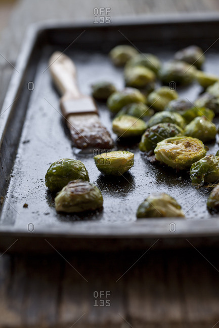 Brussel spouts on cooking sheet with brush