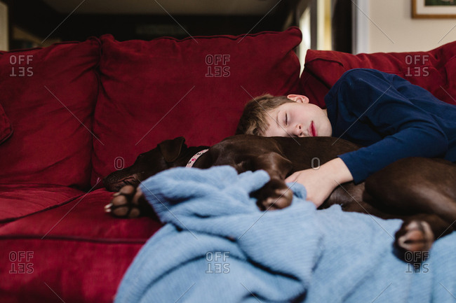Boy sleeping with his dog