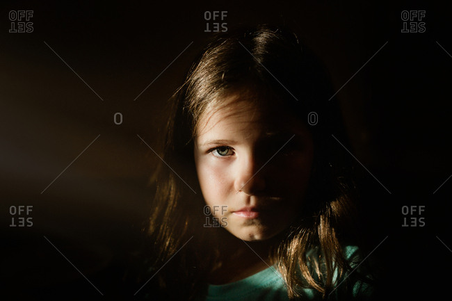 Little girl in dramatic light