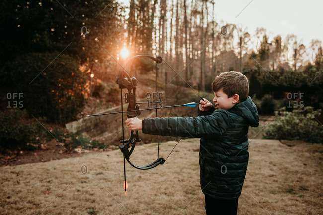Boy shooting his bow and arrow