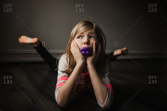 Girl with lip shaped lollipop