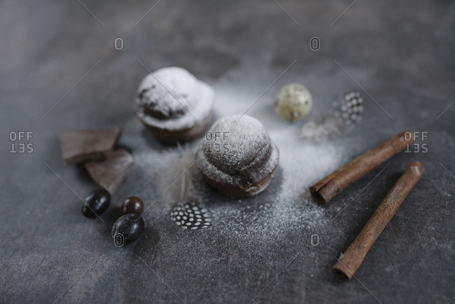 Chocolate treats with powdered sugar and cinnamon sticks