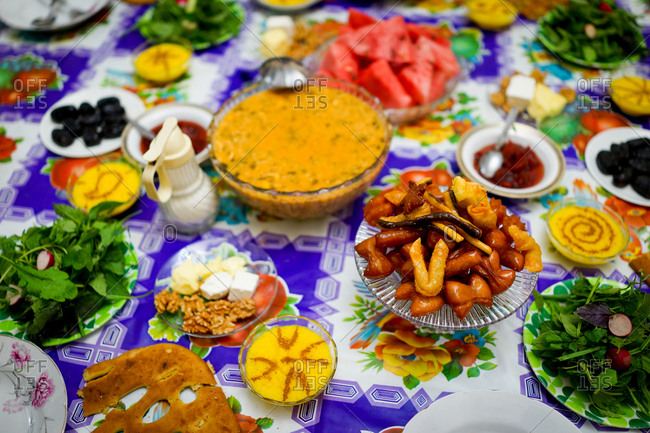 Iftar in Ramadan. Table set with lots of different delectable dishes.