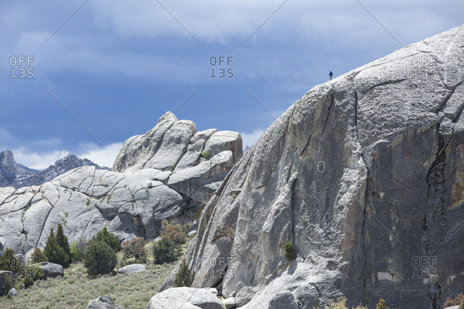 A rock climber atop Elephant Rock in City of Rocks National Reserve