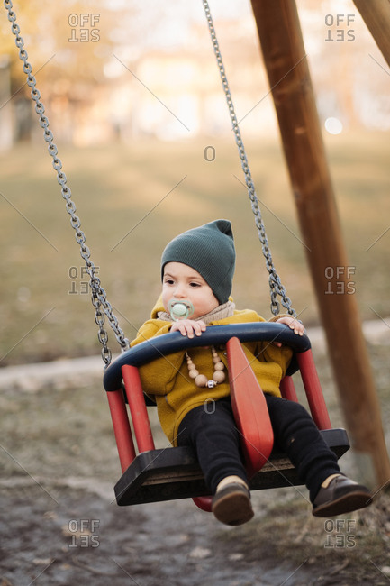 Baby swinging at a park