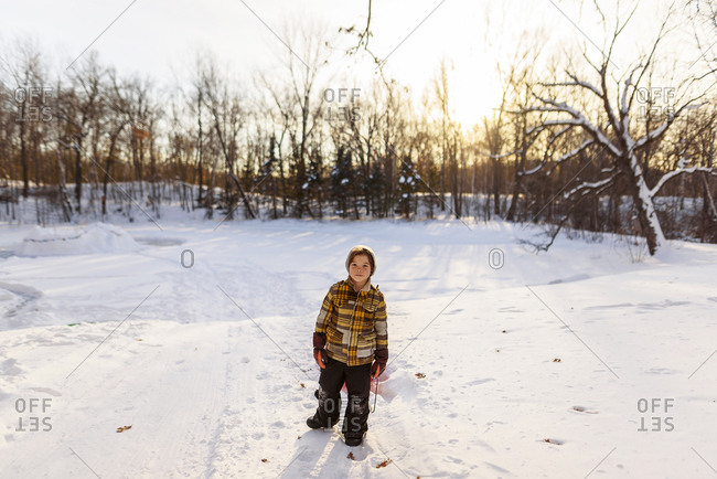 Portrait of a young boy playing in the snow