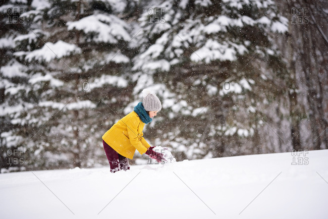 Young girl outside playing in deep snow