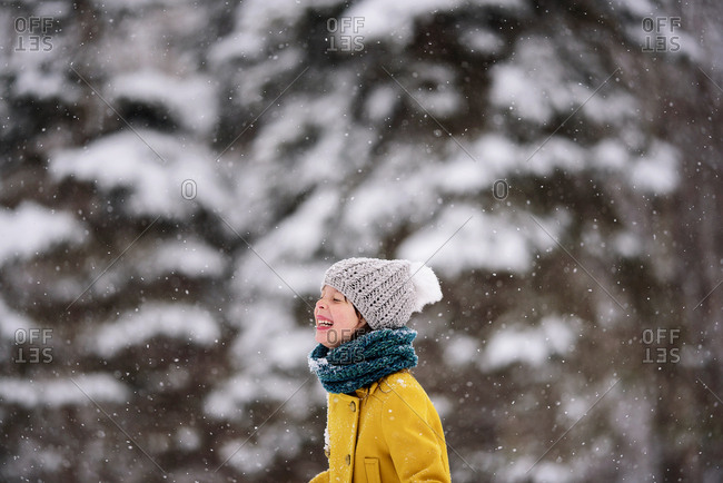 Happy little girl outside during a snowfall