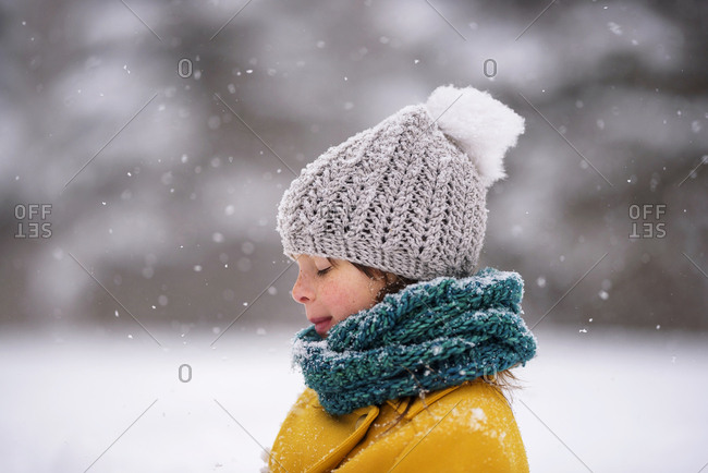 Portrait of a young girl outside during a snowfall