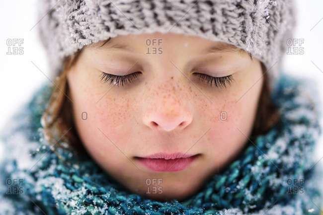 Close up portrait of a young girl outside in the snow